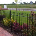 Palisade style iron vertical bar fence