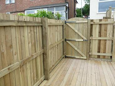 New fence with gate by worcester Fencing Solutions