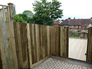 New Closeboard fencing access to decking