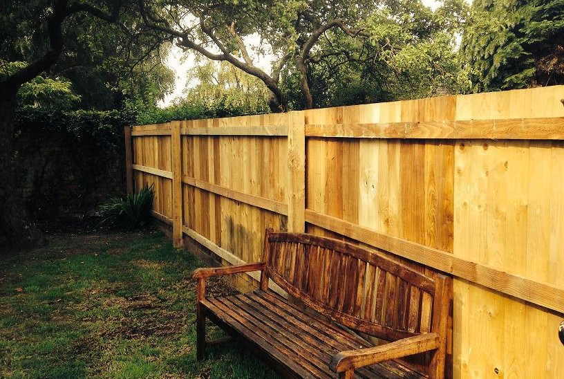 Closeboard garden fencing with rails